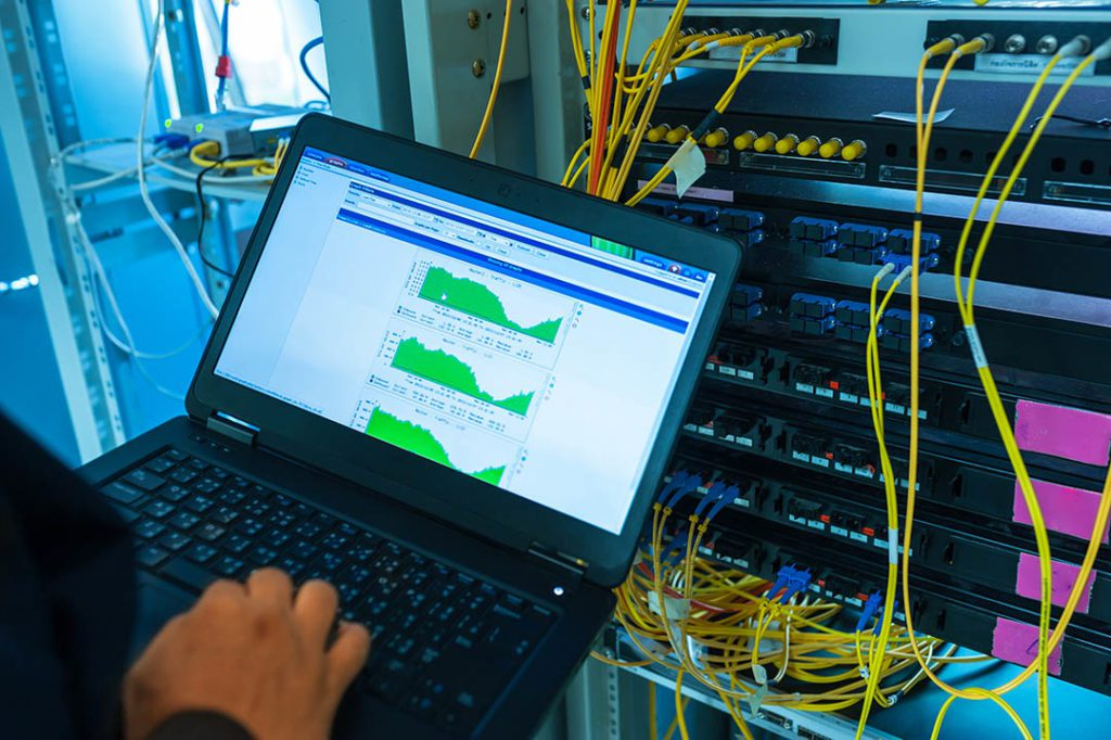 phx-IT technician, fixing network switch and server in data center room .